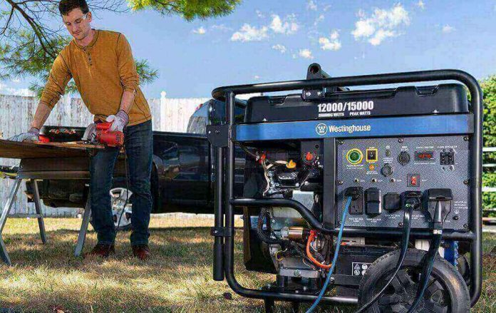 Man working with dual fuel generator